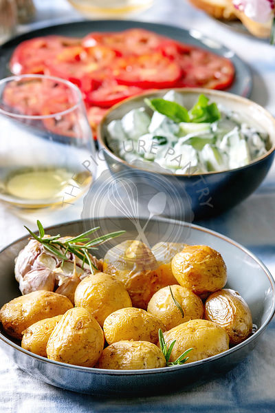 Dinner table with baked potatoes