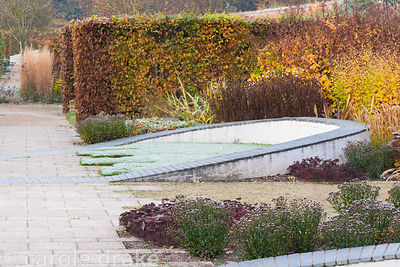 Walled garden designed by Brita von Schoenaich featuring a ribbon of grey inlaid slate looping through the space across the c...