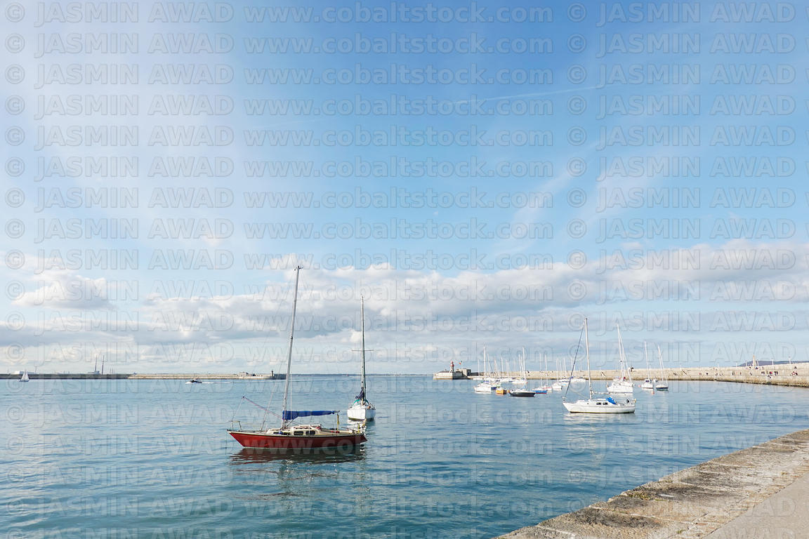 Dublin harbour with sail boats on a quiet day