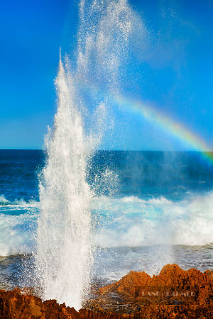 Cliff landscape with blowhole and rainbow at Point Quobba - Australia, Australia, Western Australia, Gascoyne, Point Quobba -...