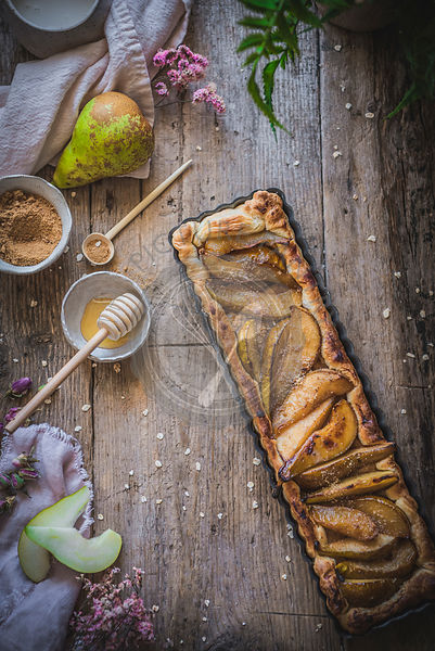 Rustic pears and almond cake in a rustic setting