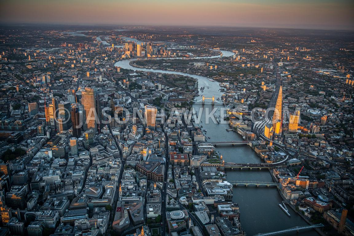 Aerial view of London, River Thames, City of London at dusk.