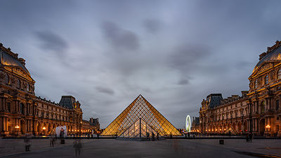 Clouds gathering over Louvre pyramid