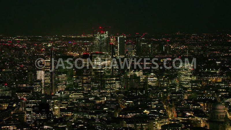 Night aerial helicopter footage of the Square Mile, City of London, London.