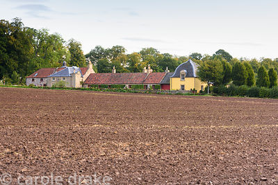 View across fields to Broadwoodside, Gifford, East Lothian in September