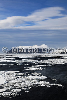 Dark sky with cloud over land, Weddell Sea, Antarctica