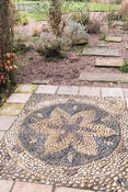 Pebble mosaic in the shape of a flower at Ellicar Gardens, Notts