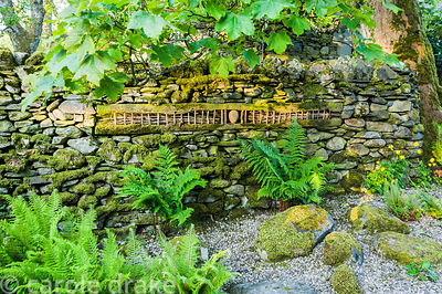 'Going by Sleeper'. Wood and stone artwork inserted into drystone wall.