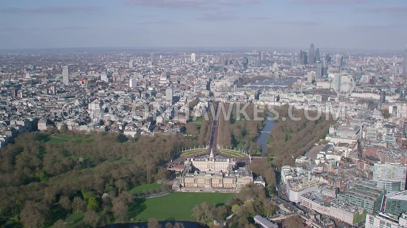 Aerial footage of Buckingham Palace, Buckingham Palace Gardens, The Mall,  Green Park, St James's Park, London .