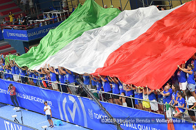 fans in the stands, while playing italian anthem