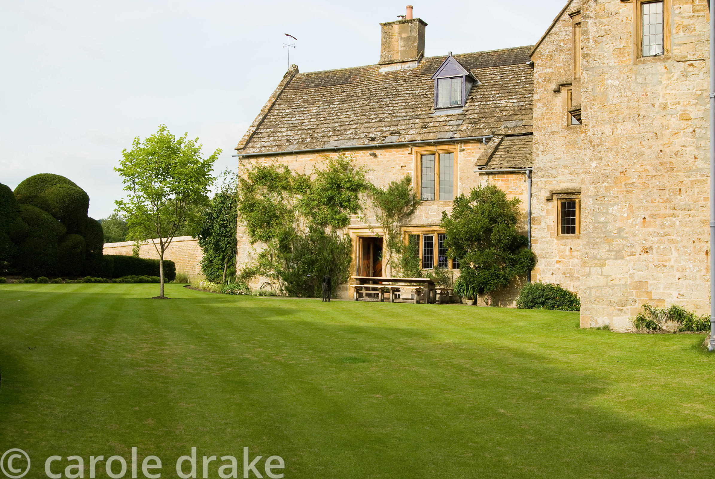 Immaculately kept lawns surround the 17th century farmhouse. Farrs, Beaminster, Dorset, UK