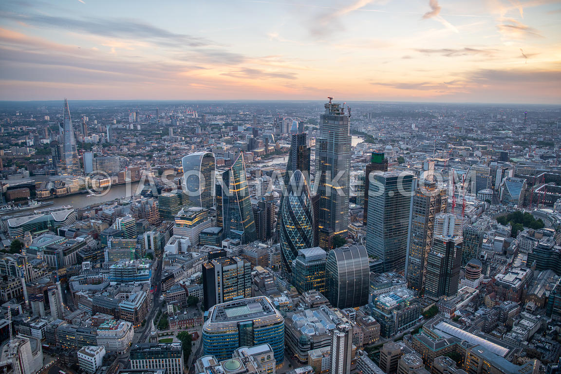 Aerial view of the City of London at sunset.