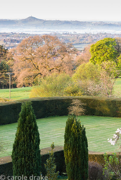 From the highest terrace of the garden there are views across the formal garden, the surrounding landscape to distant Glaston...