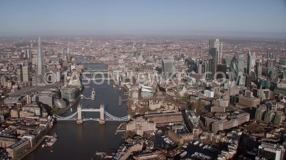 Helicopter aerial footage of London . Aerial footage of the River Thames, The Shard, Tower Bridge, City of London, St. Kathar...