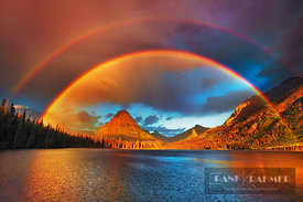 Mountain impression rainbow at Two Medicine Lake with Sinopah Mountain - North America, USA, Montana, Glacier National Park, ...