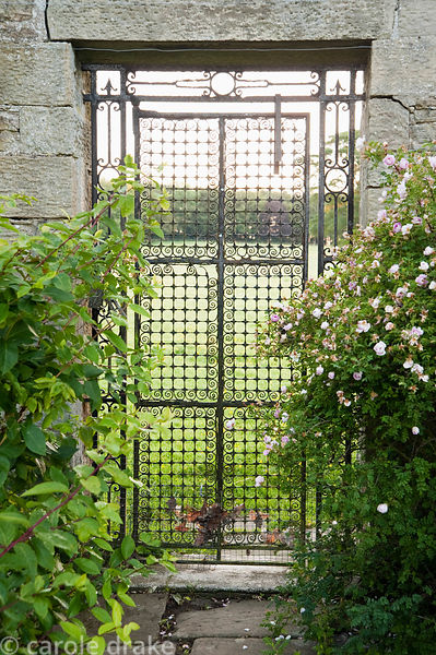 Metal gate giving views out to the surrounding fields. Whalton Manor Gardens, Whalton, Northumberland, UK