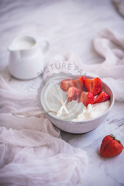 Cottage cheese, cream and strawberries
