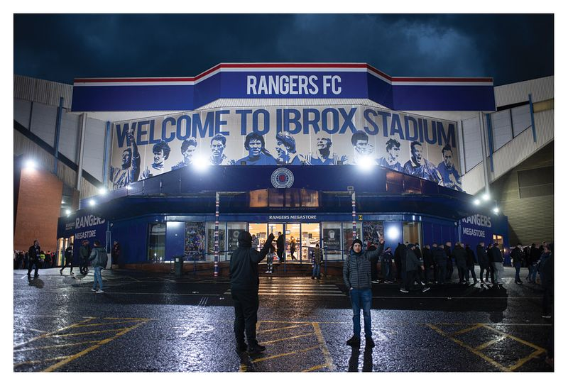 Ibrox Stadium under the lights at the last match in Scotland before the season is curtailed by Covid-19