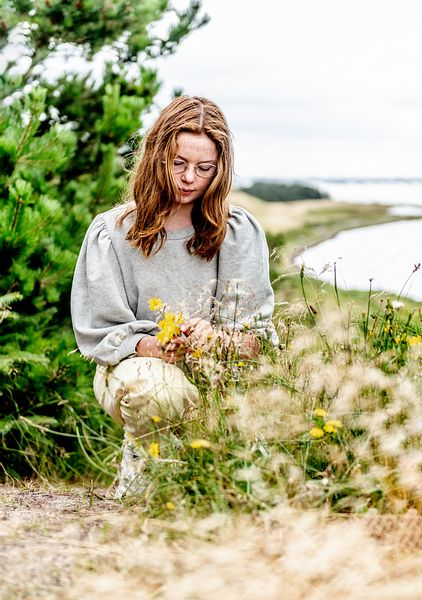 Girl picking flowers on Venø, Denmark 3