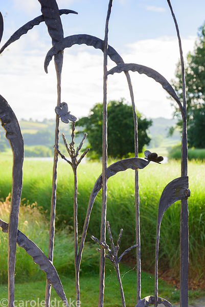 Decorative wrought iron gate picturing grasses and butterflies at the Yeo Valley Organic Garden, Blagdon, Somerset