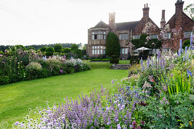 Herbaceous borders in front of the house include scabious, thalictrum, delphiniums, salvias and achilleas. Felley Priory, Und...