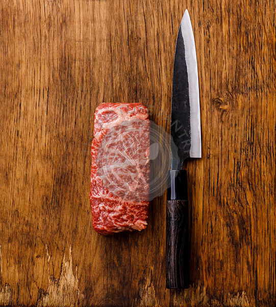 Raw fresh marbled meat Steak Wagyu beef and kitchen knife on wooden background