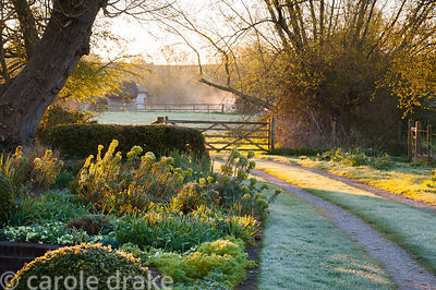 A track edges the front garden, leading down to the River Test. Terstan, Stockbridge, Hants, UK