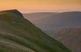 The summit of Kidsty Pike at sunrise with Long Stile to the right leading down to Riggindale valeey below in the Lake Distric...