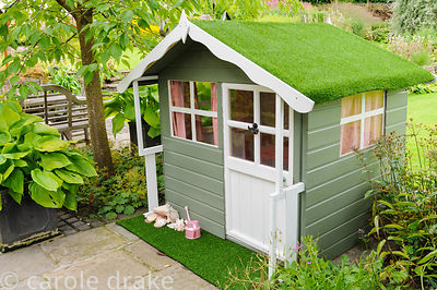 Child's wendy house topped with astroturf.