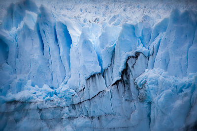 Ice folds of Perrito Moreno glacier make a constantly cracking sound as they move slowly further.