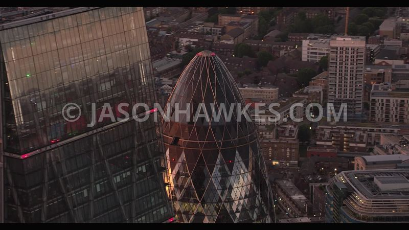 Helicopter aerial footage of The Gherkin,  30 St Mary Axe, London .