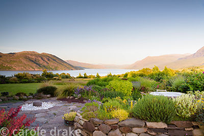 Garden on Little Loch Broom at 2 Durnamuck,  Wester Ross in July with raised beds near the house and plants including phygeli...