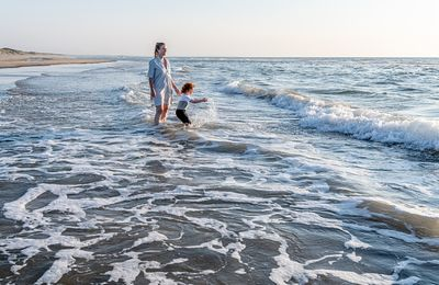 Mother and son playing at Blokhus beach 2