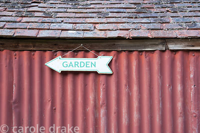 Sign to the garden hung on corrugated iron shed. Littlebredy Walled Gardens, Littlebredy, Dorset