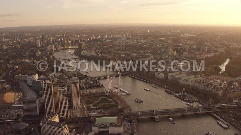 Aerial footage of SouthBank, London Eye, River Thames, Westminster, Whitehall, Houses of Parliament,  Palace of Westminster ,...