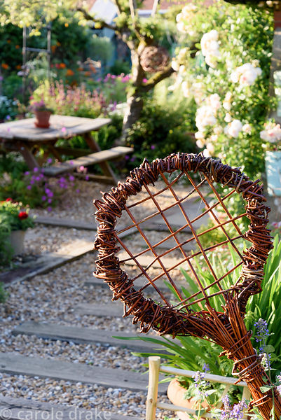 Woven willow tennis rackets made from willow grown in the garden at Malthouse Farm, Hassocks, Sussex