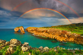 Cliff landscape with rock arch under rainbow - Europe, Spain, Asturias, Oriente, Ribadesella, Playa de Huelga (Bay of Biscay,...