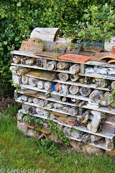 Bug hotel made of wood and tiles in sandwiched layers at Malthouse Farm, Hassocks, Sussex