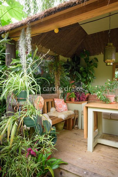 Jungle Hut constructed using recycled telegraph poles at Oak Barn, Newark, Notts in September with cushioned benches, table a...