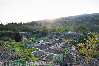 View across the Kitchen Garden from the Magic Garden with Garn Fawr and landscape beyond.