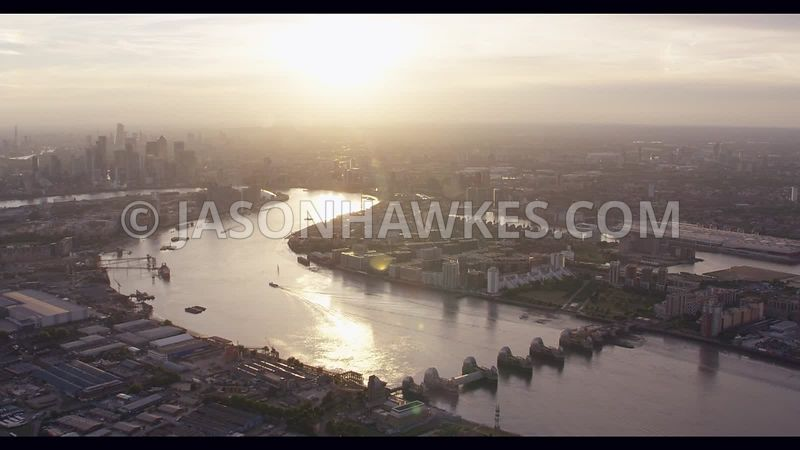 Aerial footage of Silvertown, Thames Barrier and River Thames at sunset, London .