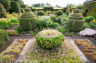 The Flower Garden features strong blocks of box and yew that frame cottage garden plants and flowers, and stone containers pl...