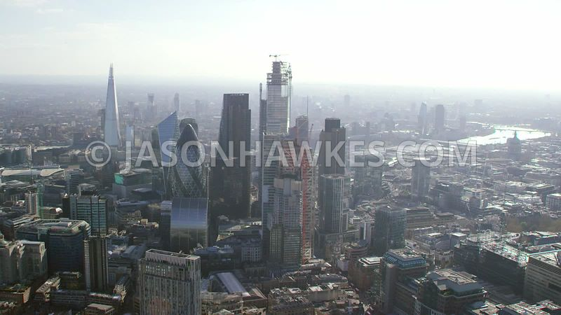 Aerial footage of the City of London, Square Mile, London. ( Shot from a helicopter in 5K )