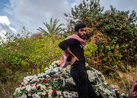 Mourners and relatives of Alaa Abu Fakher, who was killed by a Lebanese soldier in Tuesday night protests south of Beirut, at...