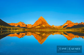 Mountain impression Swiftcurrent Lake with reflection of Mount Grinnell - North America, USA, Montana, Glacier National Park,...