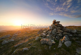 A bright orange sunset sky over the mountains of the Lake District from Ramspgill Head with views of the summits of The Knott...