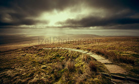 A stone path leading to the summit of Ingleborough, part of the