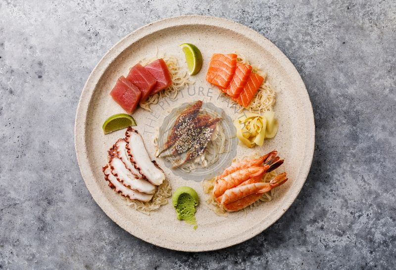 Sashimi sushi set on plate on gray background