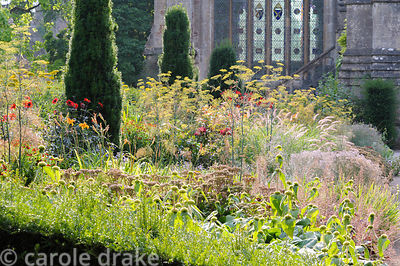Hot border in the East Garden planted with a mix of herbaceous perennials and grasses including fennel, dahlias, achilleas, P...