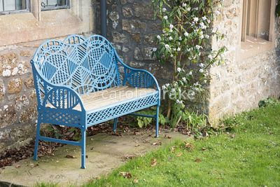 Edward Bawden-designed bench beside Daphne bholua 'Jacqueline Postill' at the Old Rectory, Netherbury in January